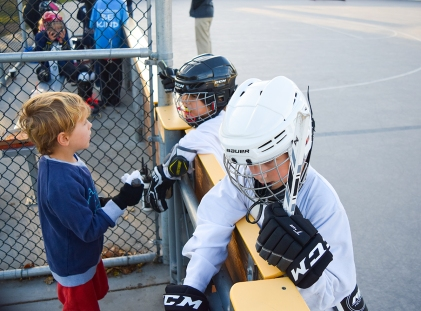 A couple of players get some advice from an avid fan.